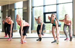 Group of women working out in gym Stock Images