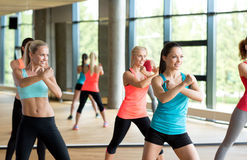 Group of women working out in gym Stock Photos