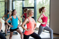 Group of women working out with steppers in gym Stock Image
