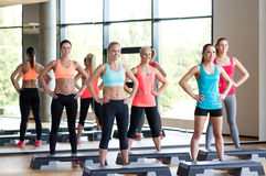 Group of women working out with steppers in gym Royalty Free Stock Photo