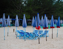 Group of wooden beach chair and umbrella on the beach Royalty Free Stock Images