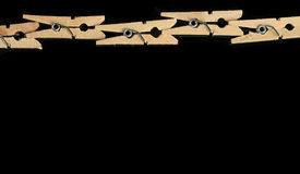 Group of wooden clothes pin in black background Stock Photo