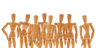 Group of wooden dummies Royalty Free Stock Photos