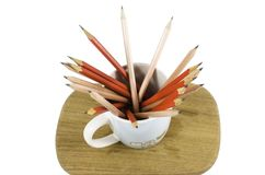 Group of wooden pencils in a cup on wooden board  Royalty Free Stock Photography