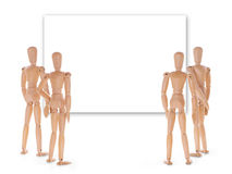 Group of wooden people looking at empty screen. Royalty Free Stock Photo