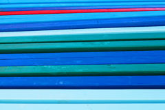Group of  wooden poles painted in vivid colours Royalty Free Stock Image