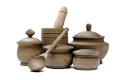 Group of wooden pots and mortar with pestle. Crockery. Wooden kitchen pots and mortar with pestel isolated on white background. Kitchenware. Kitchen utencils stock photo