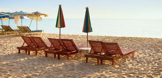 Group of wooden sunbeds on beach Royalty Free Stock Photos