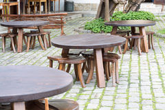 Group wooden tables in a traditional Bulgarian style on a street Stock Images