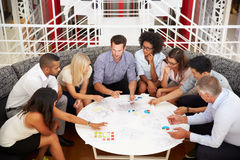 Group of work colleagues having meeting in an office lobby royalty free stock image