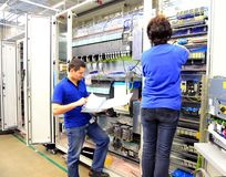 Group worker - production and assembly of microelectronics in a royalty free stock images