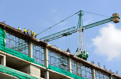 Group of the workers. Are working on high constructionsite Royalty Free Stock Images