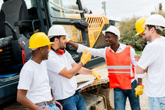 Group of workers at a building site Stock Image