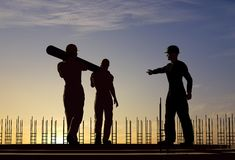 The group of workers   carry a pipe. Royalty Free Stock Photography