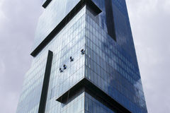 Group of workers clean the windows of high rise modern skyscraper Royalty Free Stock Photo