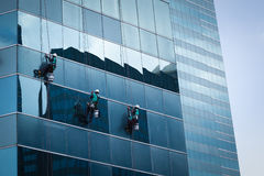 Group of workers cleaning windows service on high rise building Royalty Free Stock Photography