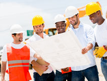 Group of workers at a construction Royalty Free Stock Image