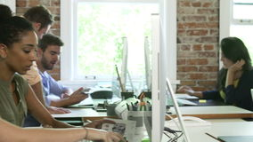Group Of Workers At Desks In Busy Design Office stock video