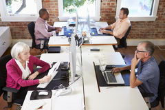 Group Of Workers At Desks In Modern Design Office Stock Image