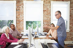 Group Of Workers At Desks In Modern Design Office Royalty Free Stock Photo