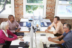 Group Of Workers At Desks In Modern Design Office Stock Photo