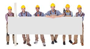 Group of workers with empty placard Royalty Free Stock Photography