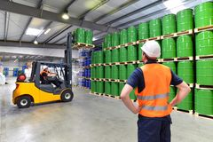 Group of workers in the logistics industry work in a warehouse w. Ith chemicals stock photo