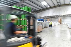 Group of workers in the logistics industry work in a warehouse w. Ith chemicals royalty free stock photo