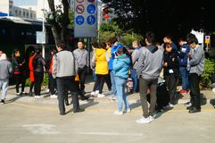 Shenzhen, China: a group of male and female workers preparing for occupational health checks at the gate of the health and epidemi. A group of workers preparing Stock Photo