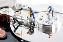 Group of workers repair hard drive Stock Photo
