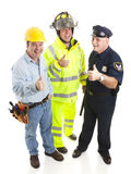 Group of Workers - Thumbsup. Group of blue collar workers - construction worker, fireman, police officer - giving thumbsup sign.  Full body isolated Stock Photography