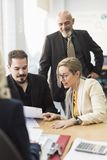 Group of workers un office looking papers royalty free stock images