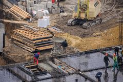 Workers working at a construction site. The group of workers working at a construction site. Top view Royalty Free Stock Photo
