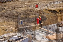 Workers working at a construction site. The group of workers working at a construction site. Top view Stock Photos