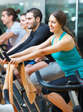 Group working out of cycling in fitness club Stock Images