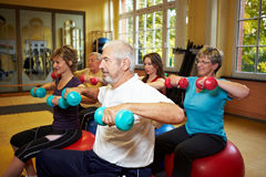 Group working out with dumbbells Royalty Free Stock Photo