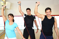 Group working out in a gym using expanders Stock Images