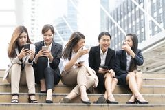 A group of working women in relaxing action stock image
