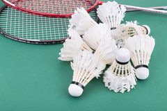 Group of worned out badminton shuttlecock with rackets on court Stock Photography