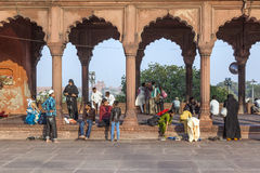 Group of worshipers rest on the courtyard of Jama Masjid Mosque Stock Photography