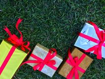 A group of wrapped gift boxes for someone special in greeting moments. They're decorating with red satin ribbon. For Christmas, new year, birthday, Valentine stock image