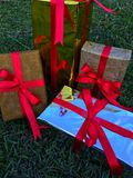 A group of wrapped gift boxes for someone special in greeting moments. They're decorating with red satin ribbon. For Christmas, new year, birthday, Valentine stock photo