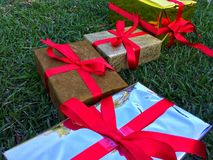 A group of wrapped gift boxes for someone special in greeting moments. They're decorating with red satin ribbon. For Christmas, new year, birthday, Valentine royalty free stock photography
