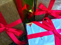 A group of wrapped gift boxes for someone special in greeting moments. They're decorating with red satin ribbon. For Christmas, new year, birthday, Valentine royalty free stock photos