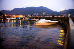 Group of yachts and boats in harbor at night Royalty Free Stock Photography