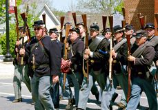 Group of Yankee Reenactors Parading in Bedford, Virginia. Bedford County, Virginia, USA – April 29th: A group of Yankee reenactors marching down a street in Stock Photo