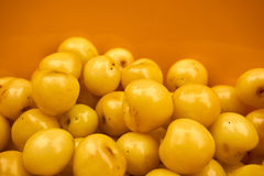 Group of yellow cherries in a yellow bowl Stock Photography