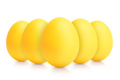Group of yellow eggs isolated on white Royalty Free Stock Photos
