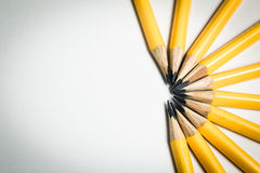 A group of yellow pencils aiming at the same center point Stock Image