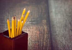 Group of yellow pencils in pencil holder Royalty Free Stock Photography